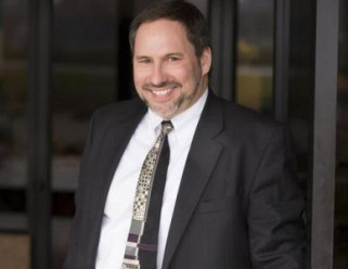 Brad Hoffman, owner of catalog printer Arandell, which filed Chapter 11 bankruptcy protection, will remain following the acquisition of Arandell by a private equity firm.