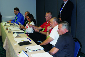 Inkjet Summit attendees review inkjet-printed samples.
