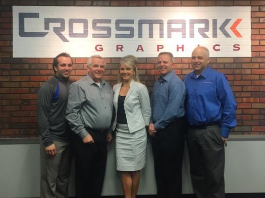 The Crossmark Graphics team, from the left: Brian Dobrzynski, James Dobrzynski Sr., Tammy Rechner, Mark Dobrzynski and Jay Dobrzynski, eagerly await the arrival of the new KBA Rapida 106 press.