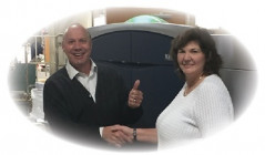 John Milich, graphic communications solutions executive, Xerox Corp.; and Joan Escover, president, JP Graphics, stand next to the new Xerox Color 1000i press.