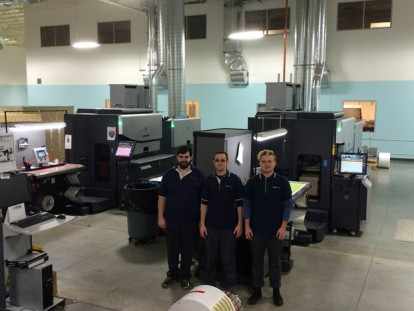 Eurostampa press operators John Neal, Cameron Schneider and Derek Clinger, stand next to the the new HP Indigo press.