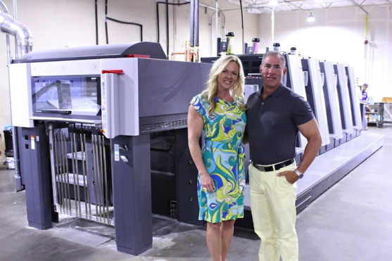Owners Lisa and Andrew Fuld with 4CP's hardworking Speedmaster XL 75 Anicolor press.