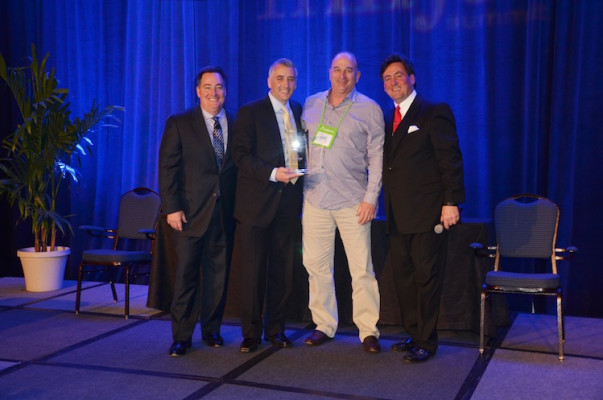 From the left, Mark Subers, Printing Impressions; David Pesko, nGage Events; Robert Kashan, CEO of EarthColor (Award recipient for Best Overall Contributing Attendee); and Philip McKay, nGage Events.