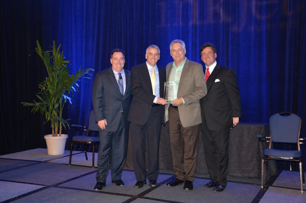From the left, Mark Subers, Printing Impressions; David Pesko, nGage Events; Mark Levin, Business Segment Manager for Publishing/PageWide Web Presses, HP (Received Award for Best Sponsor Case Study Presentation – Book Segment); and Philip McKay, nGage Events.