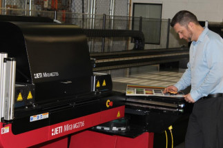 Versa-Tags' Digital Print Manager Dan Dulany works on the Jeti Mira MG2716 HS from Agfa Graphics.