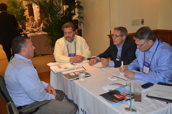 An attendee meeting with Standard for a one-on-one discussion.