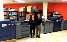 Minuteman Press franchise Owner Matthew Perry (right) and his mother Gail, alongside two Konica Minolta bizhub PRESS 1100s.