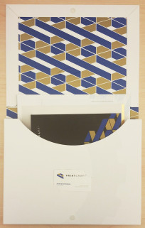 When opened, the folder neatly reveals the components, drawing attention to Print Craft's Blue and Gold logo and marketing collateral.