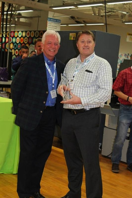 From the left, Rick Bosworth, president of ReproMAX; and the recipient of the 2016 Mike Duff Award Guy Timothy, president of SBR/Vision Graphics.