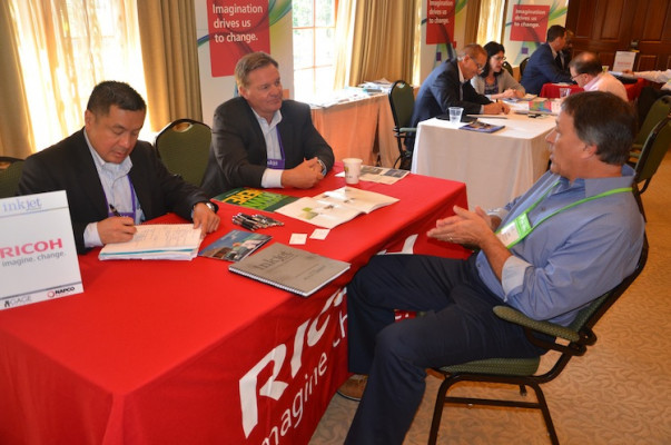 An attendee meeting with Ricoh for a one-on-one discussion.