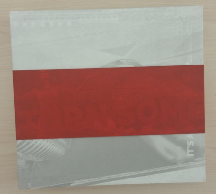 The self-promotional piece is neatly wrapped with a red paper ribbon.