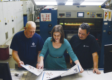 Employees of OneTouchPoint Mountain States, which is based in Denver, inspect printed output for color matches.