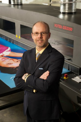 Company President Todd Meissner stands in front of the team's EFI VUTEk GS3200 wide-format printer.