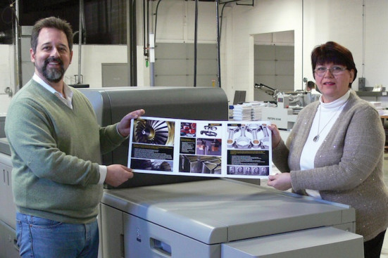 Copresco President Steve Johnson and Production Manager Lynn Buck show off a 27-1/2˝ product bulletin printed on the company's new Ricoh Pro C9100 digital color press.