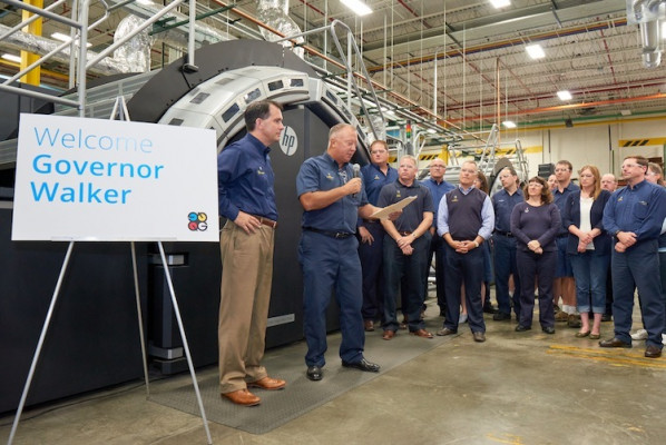 Governor Walker and Quad/Graphics COO Tom Frankowski stand in front of the HP T410.