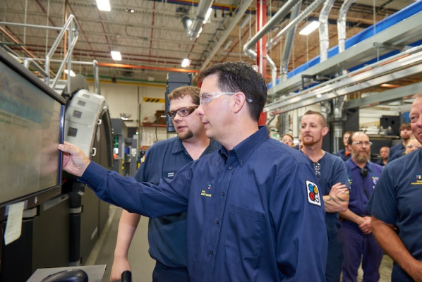 HP T410 Press Operator Steve Lentz shows Governor Walker how the press operates.