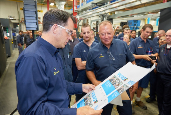 Governor Walker looks at digitally printed pages with COO Tom Frankowski.
