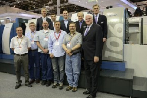 The Allied Printing Services team meets with KBA at its booth at drupa. (Top row, left to right) Ralf Sammeck, KBA president and CEO of Sheetfed Solutions; Edward Heffernan, KBA sales manager; John Sommers, president and CEO of Allied Printing Services; Mark Hischar, president and CEO of KBA North America; and KBA Group President and CEO Claus Bolza-Schünemann. (Bottom row, left to right) Kevin Howard, Allied pressroom manager; Mark Flinn, Allied finishing manager; Jim Morse, Allied digital solutions manager; Chris Gouveia, Allied senior VP of operations; Jon Kaufman, Allied senior VP of technical development; and Soren Larsen, KBA senior VP of sheetfed sales.