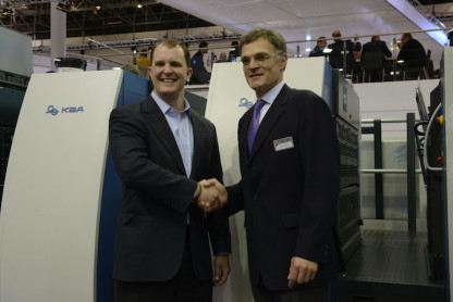 KBA Group President and CEO Claus Bolza-Schünemann (right), congratulates John Sommers, President and CEO of Allied Printing Services (left), at drupa in Germany on the purchase of its fourth new six-color, 41˝ KBA Rapida 106 high-performance press equipped with UV and conventional coating and running speeds of 20,000 sph.