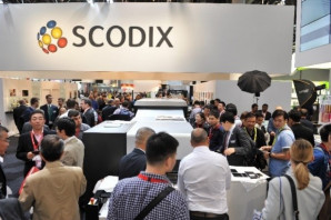 Gold-foil-finished photographs proved popular on Scodix' stand at drupa.