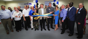 Roland DGA President Rick Scrimger (center-left) and Imagination Center Manager Scott Burgess (center-right) do the honors in a ribbon-cutting ceremony hosted by the Wilmington Chamber of Commerce for Roland DGA's new East Coast Imagination Center in Wilmington, Mass.