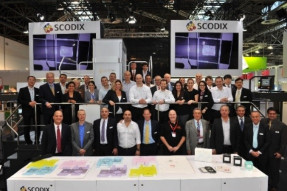 The Scodix drupa team with the new Scodix E106 press at drupa 2016.