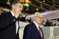 Dr. Hubert Burda with KBA president and CEO Claus Bolza-Schünemann during a tour of the KBA stand.