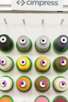 Threads at an embroidery station at the Windsor plant. Using a wide range of colored threads allows customers to upload an image to be rendered into an accurate and detailed embroidery.