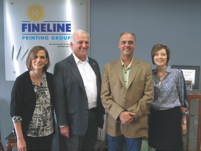 Richard Miller (second from left) stands with (from the left) Mary Kelly, director of accounting and employee relations, Ric Miller, VP of manufacturing; and Lisa Young, COO.