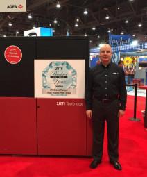 Gunther Mertens, president of Agfa Graphics, North America, with the award-winning Jeti Tauro.