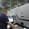 A press operator at Hammer Packaging uses the company's HP Indigo WS6600 digital press. Hammer Packaging operates digital, flexographic and offset equipment.