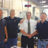Central Bindery Owner Andy Delph (left) stands with Kolbus America's Andy Hergenrother and members of the KM473 adhesive binder operating crew.