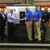 From the left, Steve Powers, HP; Haim Levit, HP; Jim Runyeon, HP; Rick Daniels, owner, QTL; Rob Daniels, president, QTL; and Mel Cox, general manager, QTL.