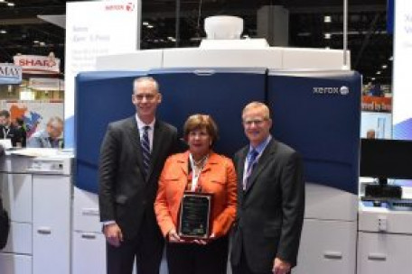 Standing, from the left, is NPES President Thayer Long; GIna Testa, VP, marketing at Xerox Corp.; and Jim Gavitt, VP, Production Color Sales, Xerox.