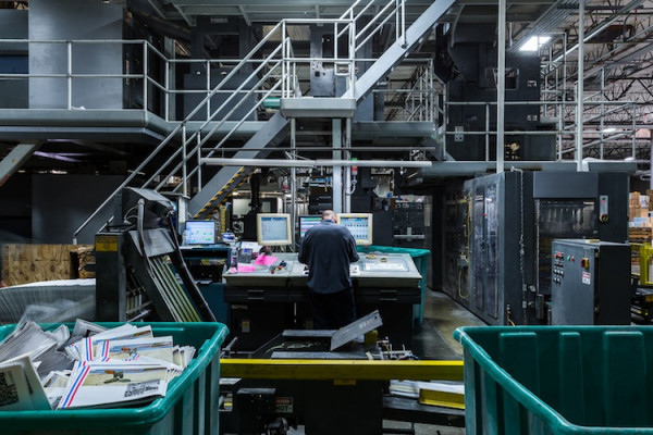 A Creel pressroom worker monitors the press console to oversee a web offset job produced at the company's Las Vegas facility.