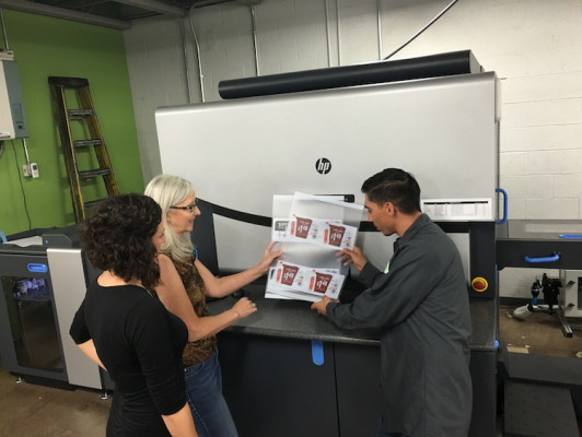 Creel Digital Division team members (shown, from left) Nicole Silverman, Sandy Brackbill and Ricky Najar work to refine a customer project produced on an HP Indigo 7900 digital press.
