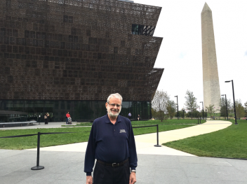 Cal Poly Professor Emeritus, Harvey Levenson, in front of the new Smithsonian Institution National Museum of African American History and Culture on The Mall in Washington, DC.
