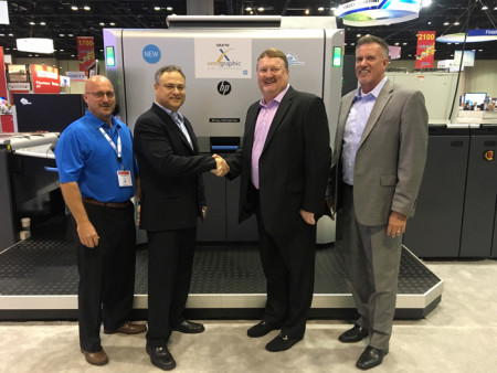 Shown, from left: HP's Chris Murphy and Haim Levit pose with Xerographic Digital Printing co-owners Keith Kemp and Steve Ebanks and their HP Indigo 12000.