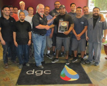 Eagle Systems President and CEO Mike King presents pressroom supervisor Gary Reyes (center right) and his D'Andrea Graphic Communications production team with their duly earned ECFC Certification Award.