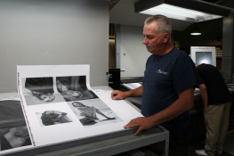 Press Operator John Cullen checks a proof from a high-fashion print job cured with Air Motion Systems' LED UV system.