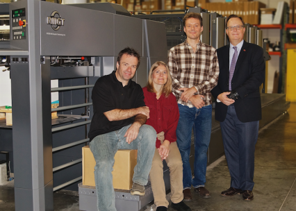 The staff at Special Editions stands next to the company's 9 Series Press from RMGT.