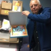 Jim Stanley, senior VP at Superior Packaging, holds the first Tasty Cookbook prototype. Image courtesy of Superior Packaging.