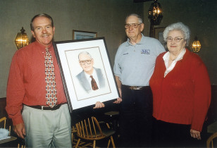 Tom Trevillian presents Woody and Maxine with his portrait when Woody retired for the first time in 1988.