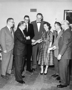 Image taken from a newspaper on March 21, 1958, when Woody Huffman (third from left) was presented a Certificate of Craftmanship. Image courtesy of McClung Cos.