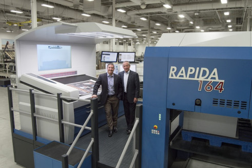 From left to right, John Hans, CEO of Imagine! and Robert Lothenbach, founder of Imagine!, proudly stand on the deck of its tenth KBA press — a Rapida 164 full UV press at its Shakopee, Minn., facility.