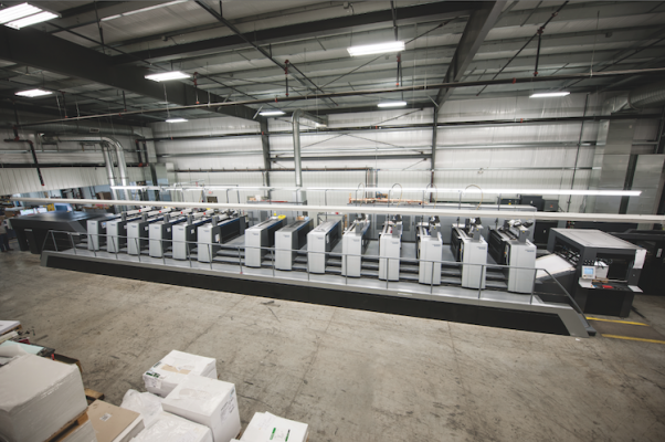The newly installed 10-color Speedmaster XL 106 perfector is equipped with double aqueous coating units and a CutStar system.