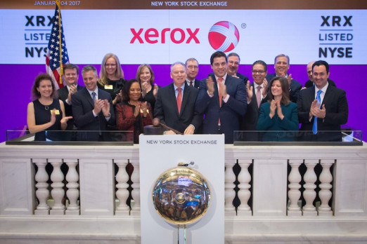 Members of the Xerox executive leadership team, employees and customers rang the opening bell at the New York Stock Exchange yesterday.