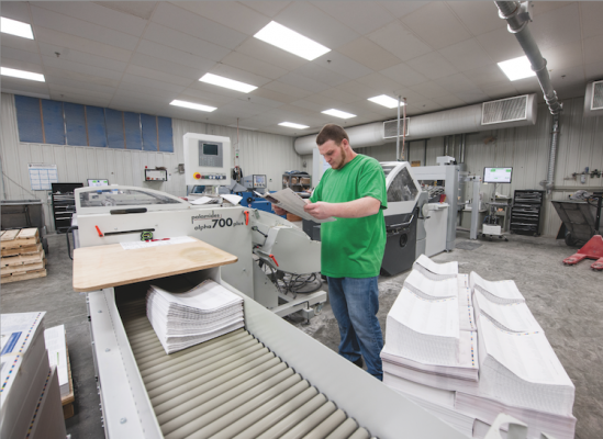 Geffry Morris inspects signatures folded on Modern Litho's Stahl folder KH 82 with PFX feeder.