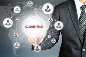 Hand pointing on ACQUISITION sign with businesspeople icon network on virtual screen