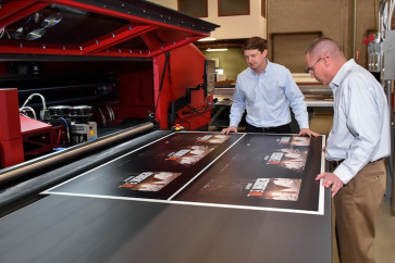 (From left) Stephen Horne, president (Atlanta Division), and Jim Hill, director of operations (Atlanta Division), inspect a job coming off of Drummond's EFI VUTEk HS125 printer.